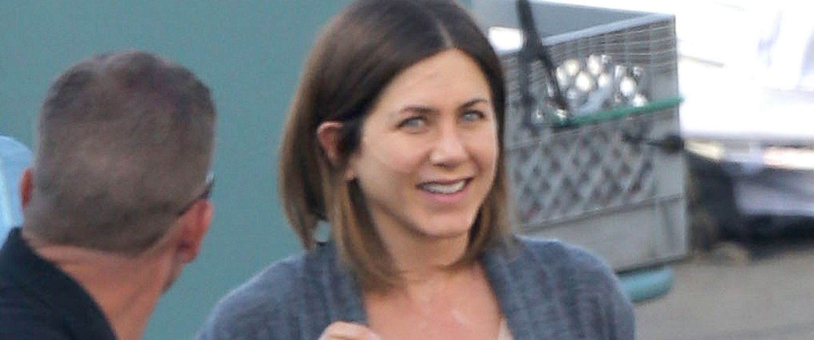 "PHOTO: Jennifer Aniston has a few laughs with one of the crew members on the set of her new movie ""Cake""."