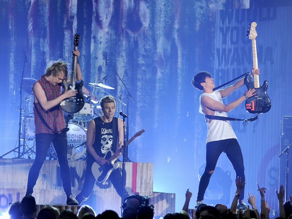 PHOTO: Michael Clifford, from left, Luke Hemmings and Calum Hood, of the musical group 5 Seconds of Summer, perform on stage at the Billboard Music Awards at the MGM Grand Garden Arena, May 18, 2014 in Las Vegas.