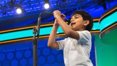 PHOTO: Six-year-old Akash Vukoti, of San Angelo, Texas, the youngest contestant in the 2016 National Spelling Bee, pulls down his microphone to compete in the preliminaries of the Bee at National Harbor, Md., on May 25, 2016.