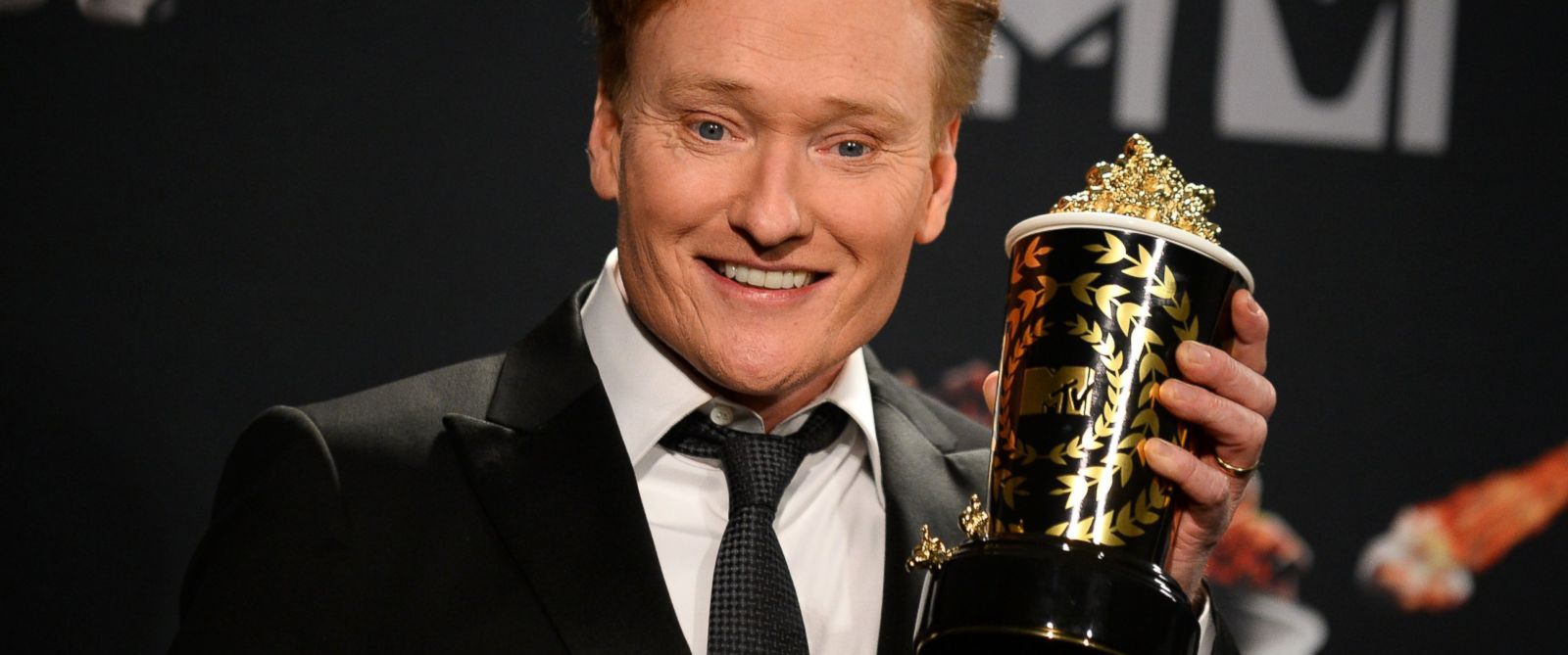 PHOTO: Conan OBrien poses in the press room at the MTV Movie Awards, April 13, 2014, at Nokia Theatre in Los Angeles.