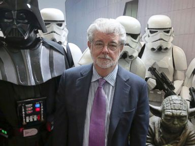PHOTO: Star Warscreator George Lucas poses with characters from the movies Star Wars during the opening ceremony of the Sandcrawler building on Jan. 16, 2014 in Singapore.