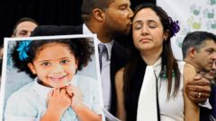 PHOTO: Jimmy Greene kisses his wife Nelba Marquez-Greene as he holds a portrait of their daughter, Sandy Hook School shooting victim Ana Marquez-Greene at a news conference at Edmond Town Hall in Newtown, Conn., Jan. 14, 2013.