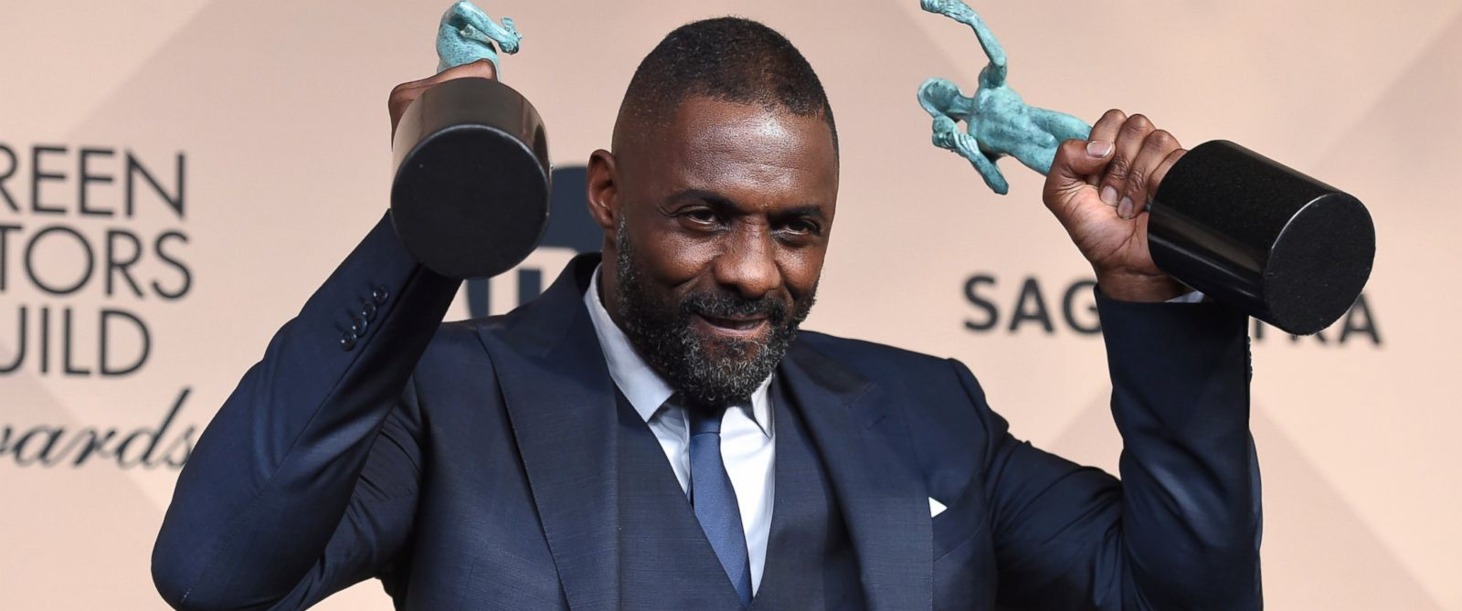 PHOTO: Idris Elba poses with the award for outstanding male actor in a supporting role for ?Beasts of No Nation? and the award for outstanding male actor in a TV movie or miniseries for ?Luther? at the SAG Awards, Jan. 30, 2016, in Los Angeles.