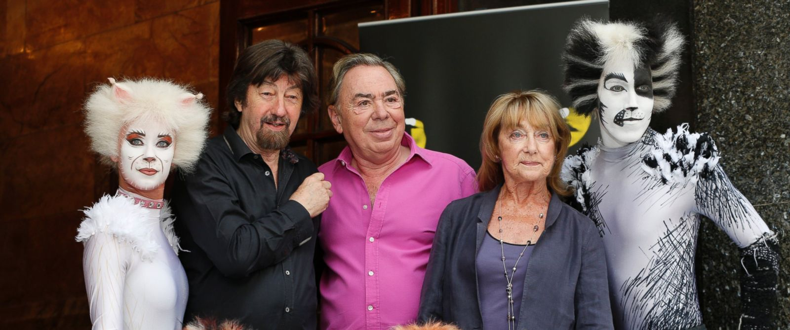 PHOTO:Andrew Lloyd Webber, center, Trevor Nunn, left, and Gillian Lynne, center right, pose for photographers with performers in cat costumes, during a photo-op to promote the return of the musical Cats, in London, in this July 7 2014 file photo.