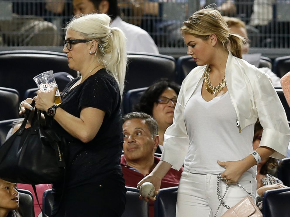 PHOTO: Supermodel Kate Upton, right, carries her baseball as she leaves a game between the Detroit Tigers and the New York Yankees at Yankee Stadium, Aug. 4, 2014.
