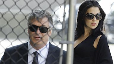 PHOTO: Alec Baldwin, left, and his wife Hilaria Thomas arrive at Cathedral Church of Saint John the Divine before funeral services actor James Gandolfini, June 27, 2013, in New York.