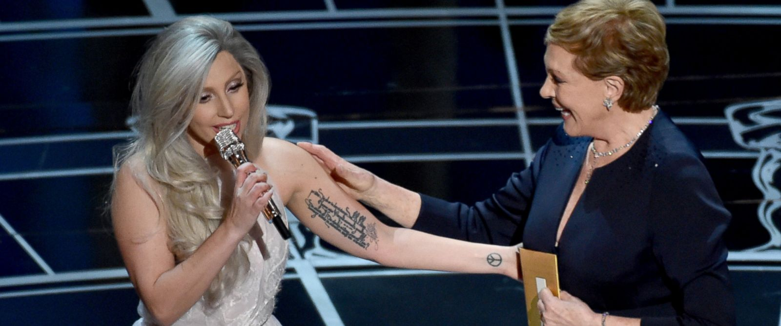 PHOTO: Lady Gaga, left, and Julie Andrews, right, speak at the Oscars on Feb. 22, 2015 in Los Angeles.