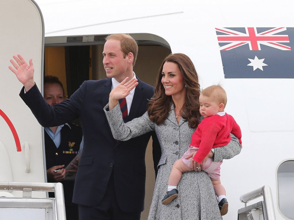 PHOTO: Britains Prince William and Kate, the Duchess of Cambridge, with son Prince George, stand atop of the stairs and wave good bye as they board their flight in Canberra, Australia.