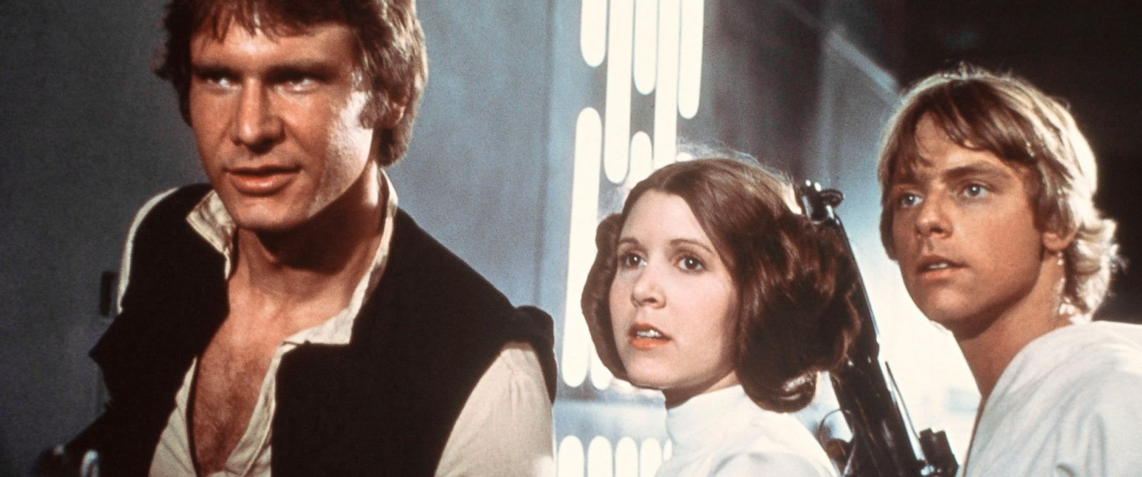 "PHOTO: Harrison Ford as Han Solo, Carrie Fisher as Princess Leia Organa and Mark Hamill as Luke Skywalker in a scene from the ""Star Wars"" movie released by 20th Century-Fox in 1977."