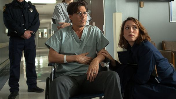 """PHOTO: Johnny Depp, left, as Will Caster and Rebecca Hall as Evelyn Caster in """"Transcendence."""""""