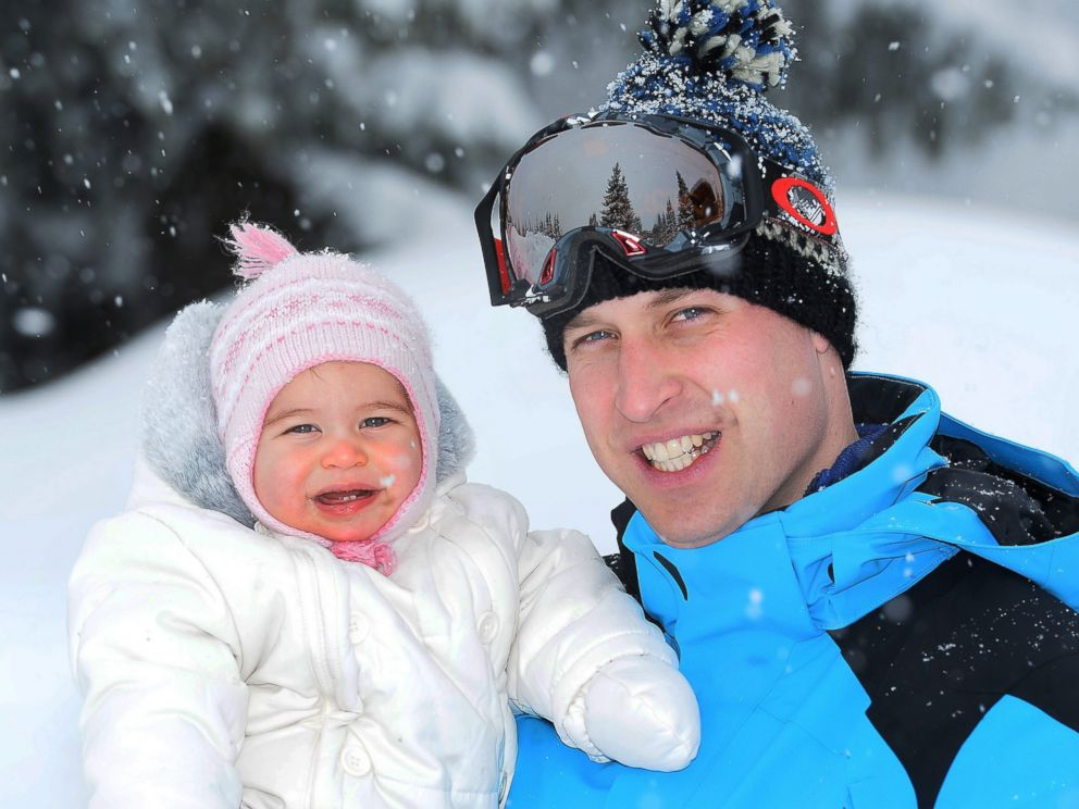 PHOTO: A picture made available March 7, 2016 shows Prince William (R), Duke of Cambridge cuddling his daughter Princess Charlotte of Cambridge as he and his family enjoy a short private break skiing in the French Alps, France, March 3, 2016.