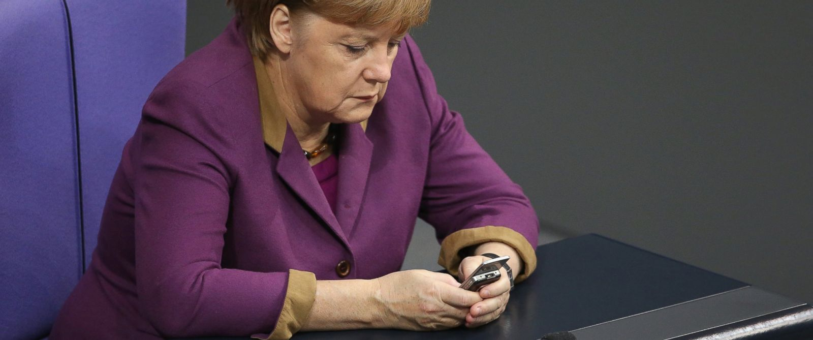 PHOTO: German Chancellor Angela Merkel checks her mobile phone during a session of the Bundestag on November 30, 2012 in Berlin, Germany.