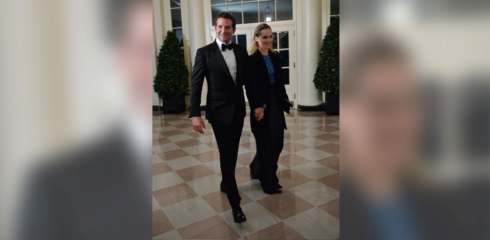 PHOTO: Actor Bradley Cooper and Suki Waterhouse arrive at the White House for the state dinner in honor of French President Francois Hollande on Feb. 11, 2014.