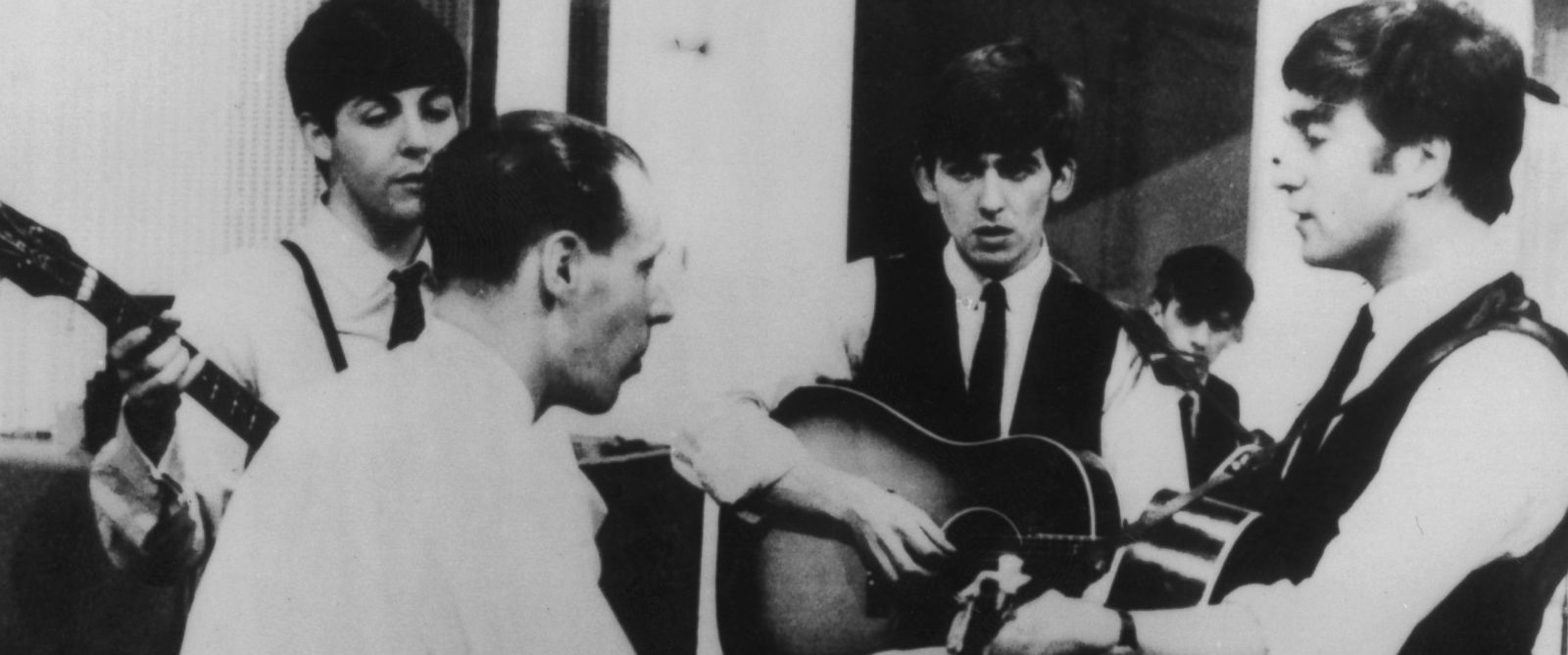 PHOTO:The Beatles at a recording session for the Parlophone label with their producer George Martin, circa 1963.