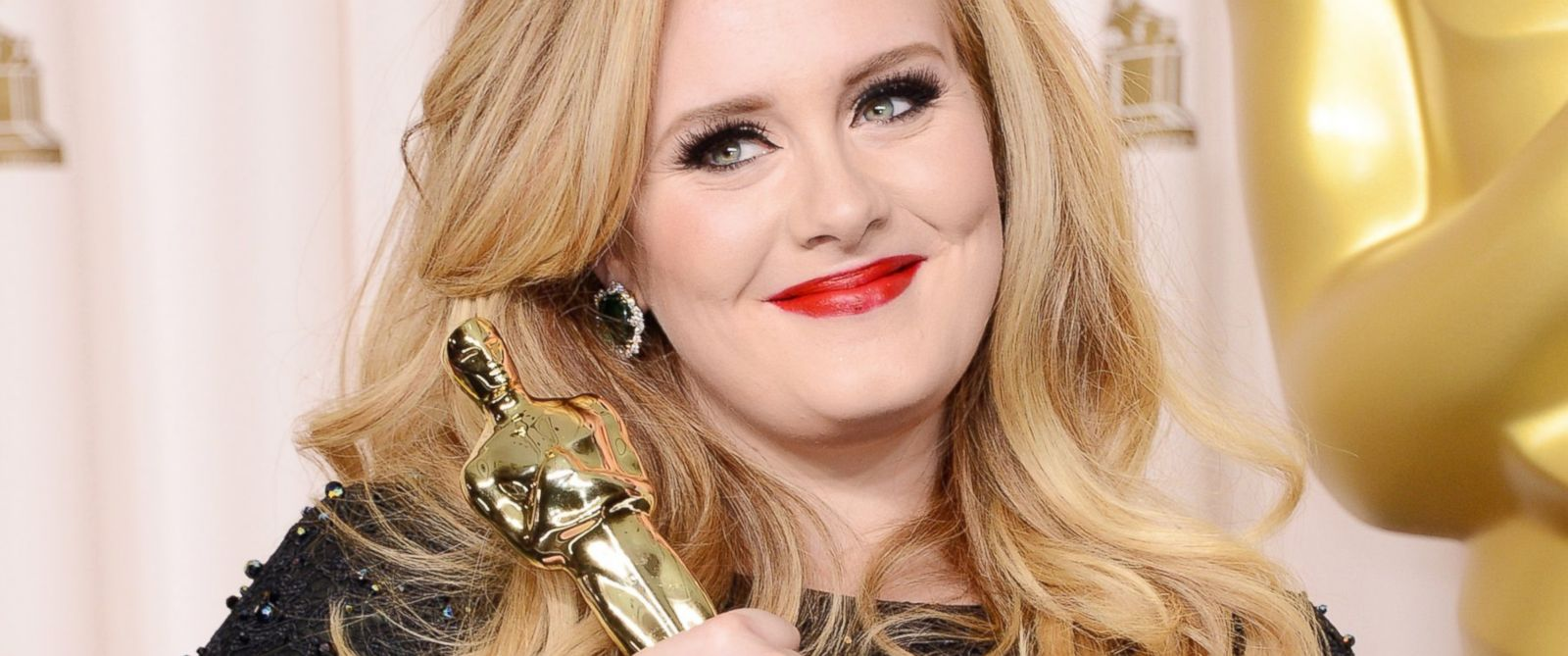 PHOTO: Adele poses in the press room during the Oscars, Feb. 24, 2013 in Hollywood, Calif.