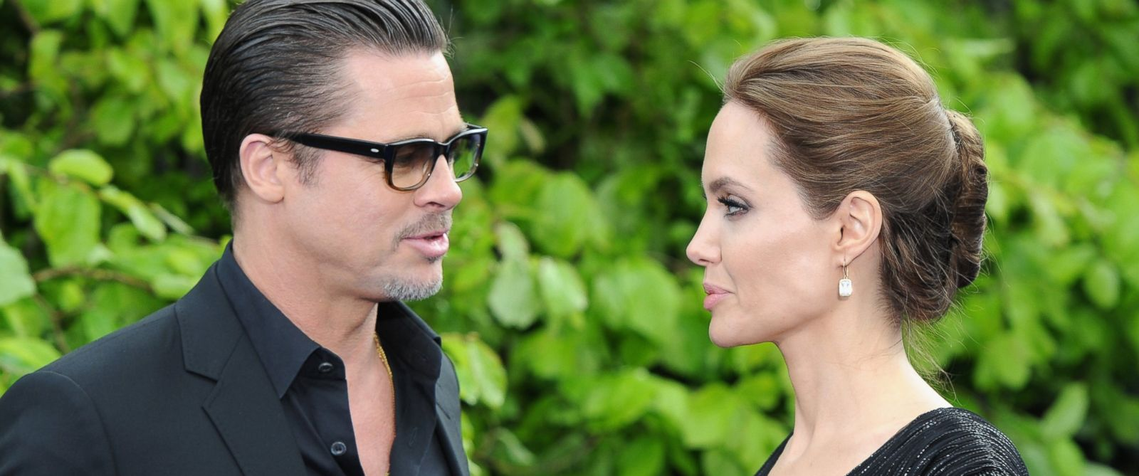 "PHOTO: Brad Pitt and Angelina Jolie attends a private reception as costumes and props from Disneys ""Maleficent"" are exhibited in support of Great Ormond Street Hospital at Kensington Palace, May 8, 2014, in London."