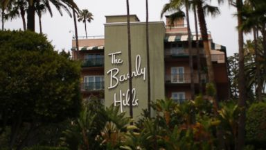 PHOTO: The Beverly Hills Hotel, which is owned by the Sultan of Brunei, is seen as nearby demonstrators protest draconian punishment of women and gay people has been announced by the Sultan on May 5, 2014 in Beverly Hills, Calif.
