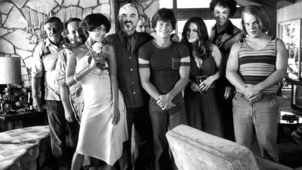 "PHOTO: (L-R) Jack Wallace, Rickey Jay Nicole, Ari Parker, Burt Reynolds, William H Macy, Mark Wahlberg, Julianne Moore, John C. Reilly and Phillip Seymour Hoffman pose on set of the movie ""Boogie Nights"" circa 1997."