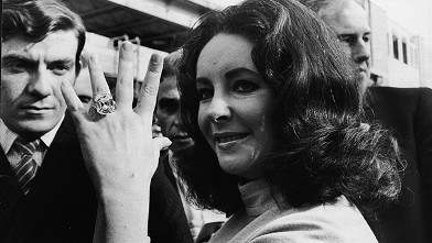 PHOTO:British-born actress Elizabeth Taylor shows off the 33.19 carat diamond ring given to her by husband Richard Burton.