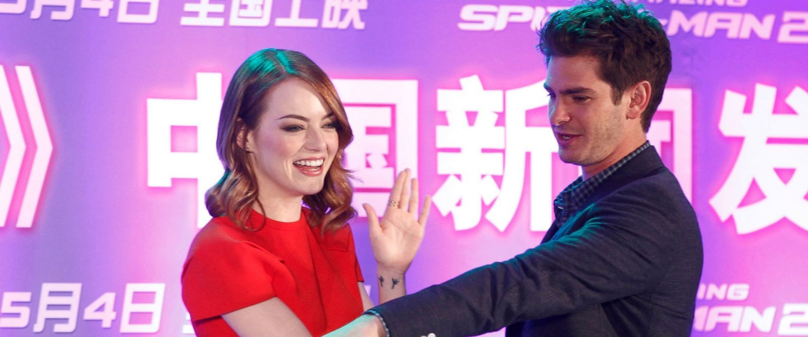 "PHOTO: Actress Emma Stone and actor Andrew Garfield attend ""The Amazing Spider-Man 2: Rise of Electro"" press conference at Palace Cinema on March 25, 2014 in Beijing, China."