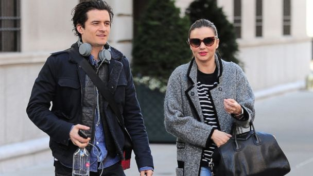 PHOTO: Orlando Bloom and Miranda Kerr walk together in New York, Dec. 13, 2013.