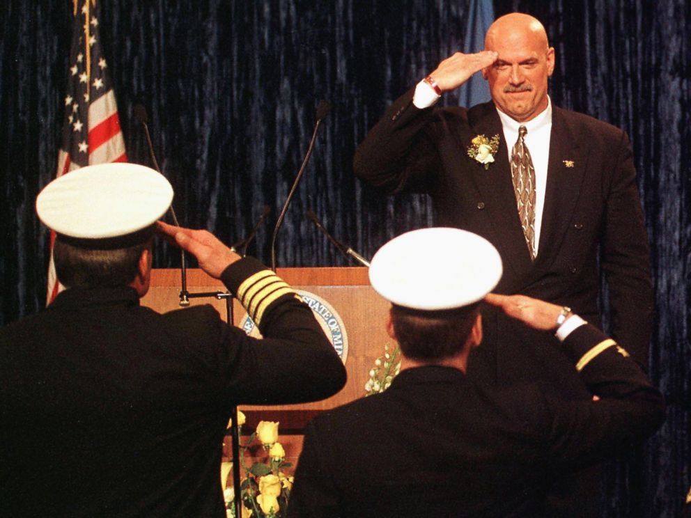 PHOTO: Minn. Governor Jesse Ventura salutes Naval Officers he invited to his inaugural after taking the oath of office to become Minnesotas 38th governor at the State Capitol in St. Paul, Minn., Jan. 4, 1999.