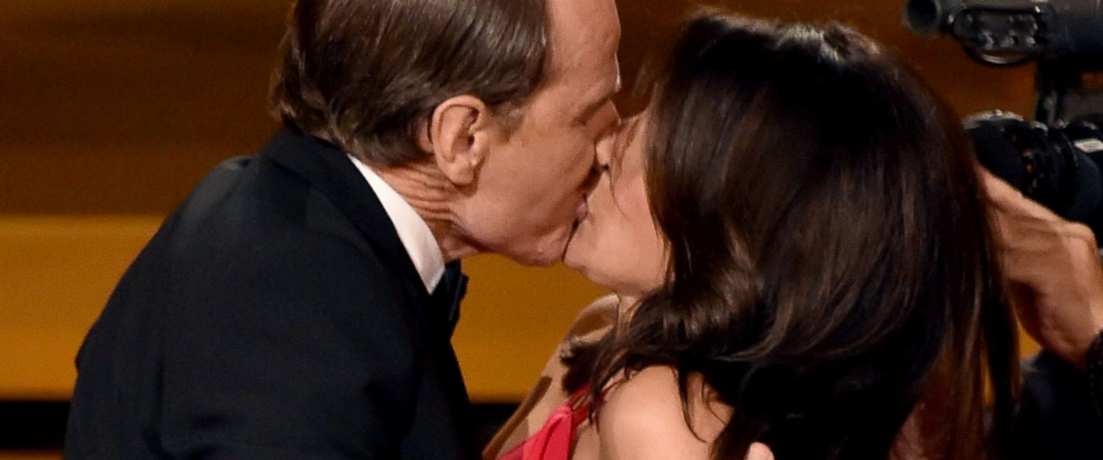 PHOTO: Actress Julia Louis-Dreyfus, right, wins Outstanding Lead Actress in a Comedy Series for Veep and kisses actor Bryan Cranston onstage at the 66th Annual Primetime Emmy Awards held at Nokia Theatre L.A. Live on Aug. 25, 2014 in Los Angeles.