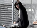 PHOTO: Justin Bieber waves after exiting from the Turner Guilford Knight Correctional Center, Jan. 23, 2014, in Miami.