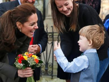 Duchess Kate Accepts Flowers From a Young Well-Wisher