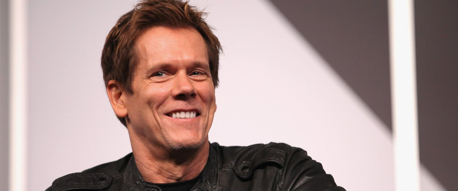 """PHOTO: Actor Kevin Bacon speaks onstage at """"6 Degrees of Kevin Bacon: A Social Phenomenon Turns 20"""" during the 2014 SXSW Music, Film + Interactive Festival at Austin Convention Center on March 8, 2014."""