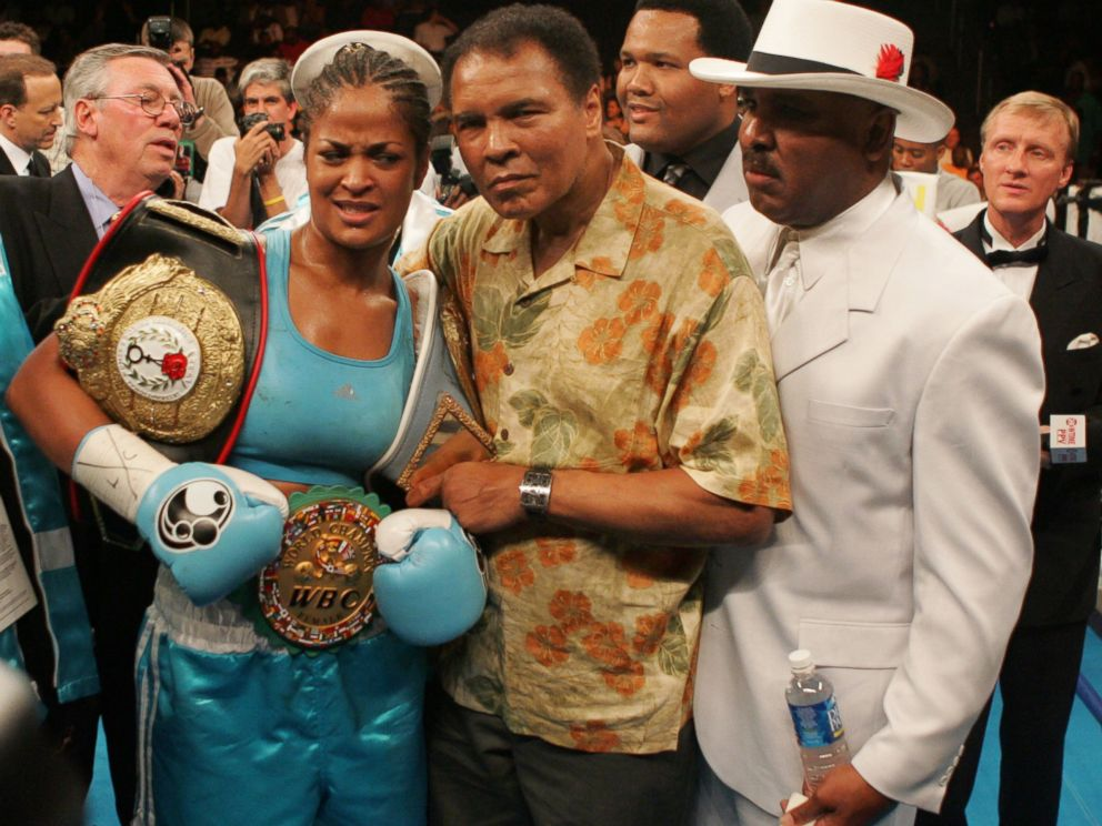 PHOTO:Laila Ali poses with her father, Muhammad Ali, after her 10 round WBC/WIBA Super Middleweight title bout with Erin Toughill, June 11, 2005, in Washington.