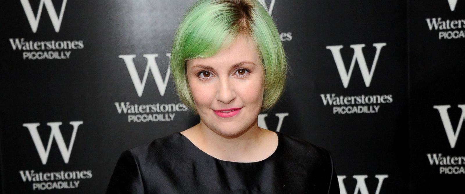 """PHOTO: Lena Dunham meets fans and signs copies of her book, """"Not That Kind of Girl,"""" at Waterstones, Piccadilly, Oct. 29, 2014, in London."""