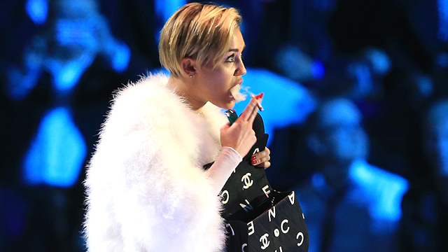 PHOTO:Miley Cyrus smokes onstage at the MTV EMAs in Amsterdam.