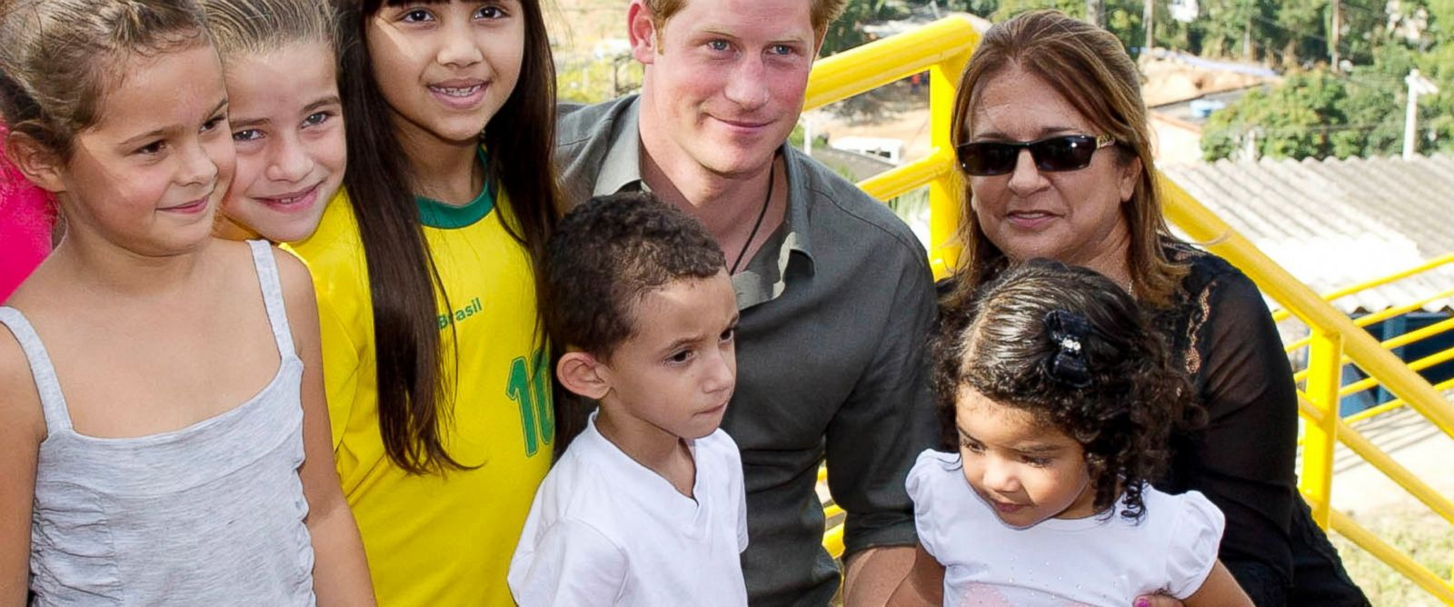 PHOTO: Prince Harry poses with local children from a village during a trip to Brazil