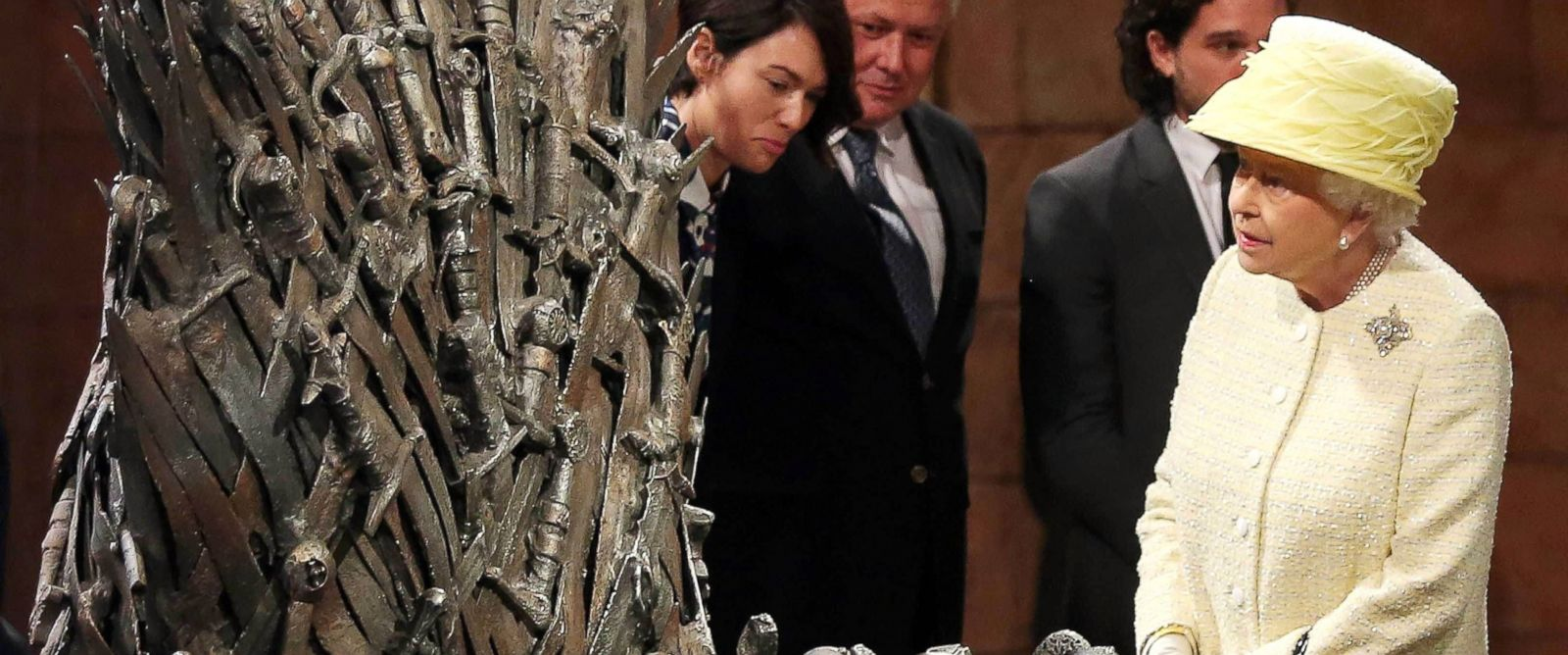 PHOTO: Queen Elizabeth II meets cast members of the HBO TV series Game of Thrones Lena Headey and Conleth Hill as she views some of the props including the Iron Throne on the set of Game of Thrones in Belfasts Titanic Quarter, June 24, 2014.