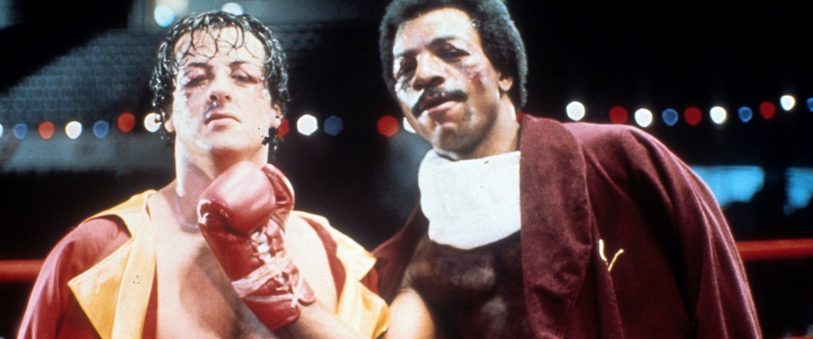 "PHOTO: Sylvester Stallone and Carl Weathers on set of the film ""Rocky."""