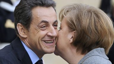 PHOTO: French President Nicolas Sarkozy, kisses German Chancellor Angela Merkel upon her arrival for a joint Franco-German cabinet session at the Elysee Palace, Feb. 6, 2012, in Paris.