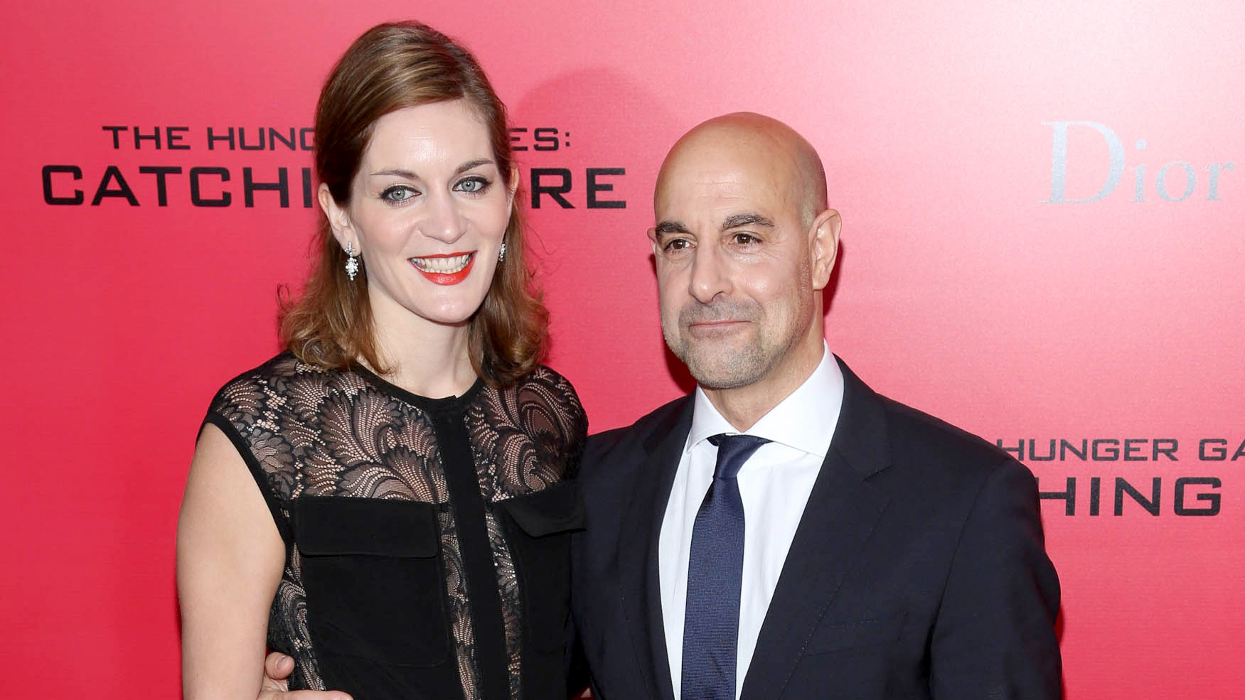 """PHOTO:Stanley Tucci (R) and Felicity Blunt attend a special screening of """"The Hunger Games: Catching Fire"""" on Nov. 20, 2013 in New York City."""