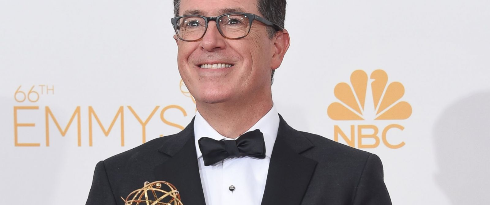 PHOTO: Writer/Producer/Host Stephen Colbert, winner of the for Outstanding Variety Series Award for The Colbert Report, poses in the press room during the 66th Annual Primetime Emmy Awards held at Nokia Theatre L.A. Live, Aug. 25, 2014 in Los Angeles.
