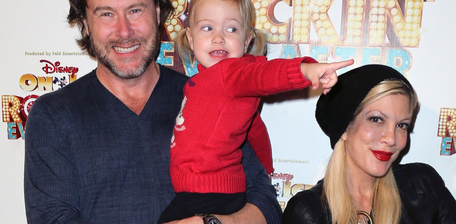 PHOTO: Dean McDermott and Tori Spelling pose with daughter Hattie Margaret McDermott