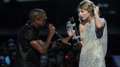 "PHOTO: Kayne West, left, jumps onstage as Taylor Swift accepts her award for the ""Best Female Video"" award during the 2009 MTV Video Music Awards at Radio City Music Hall in this Sept. 13, 2009, file photo in New York City."