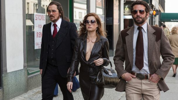 "PHOTO: Christian Bale, left, as Irving Rosenfeld, Amy Adams as Sydney Prosser, and Bradley Cooper as Richie Dimaso walking down Lexington Avenue in a scene from Columbia Pictures film, ""American Hustle."""