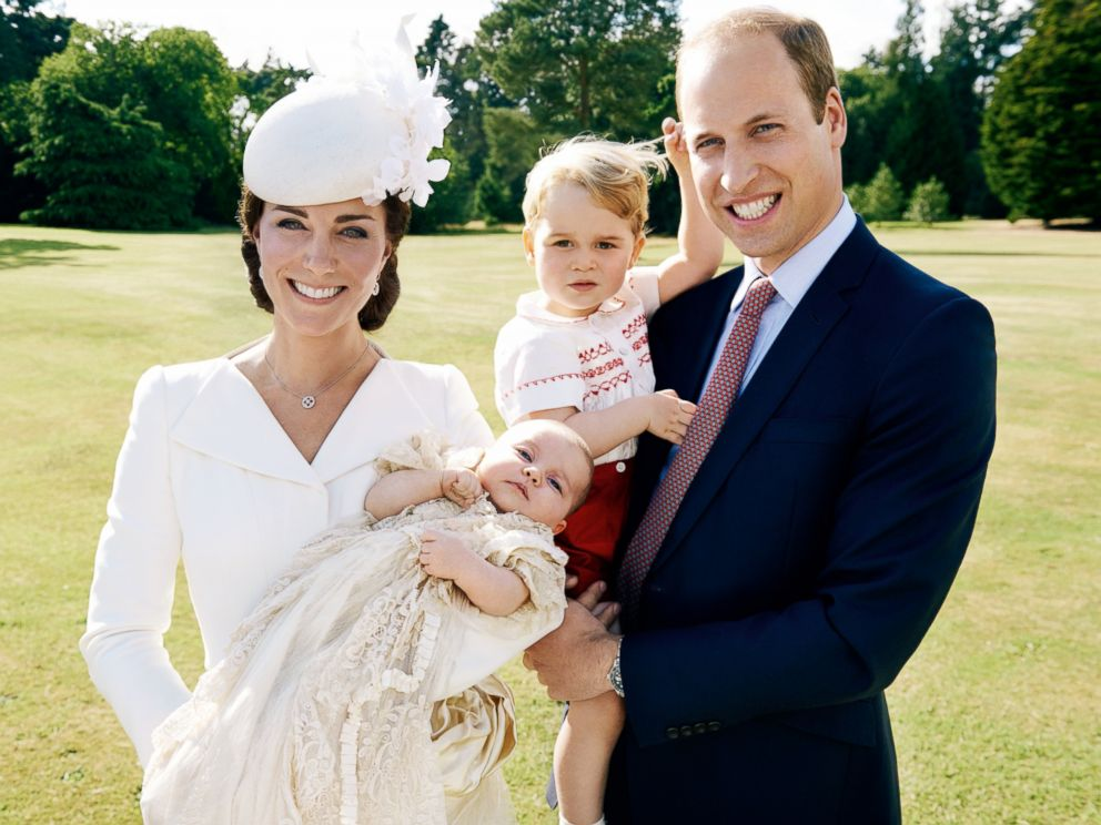 PHOTO: The Duke and Duchess of Cambridge are seen with Prince George and Princess Charlotte in the garden at Sandringham House.