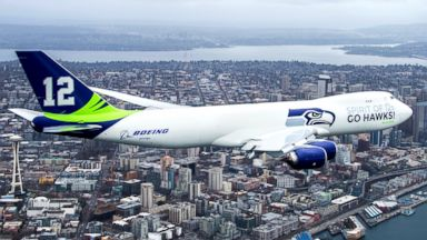 PHOTO: Seen flying above Seattle is Boeings newly painted 747-8 Freighter to show their support for the Seattle Seahawks.
