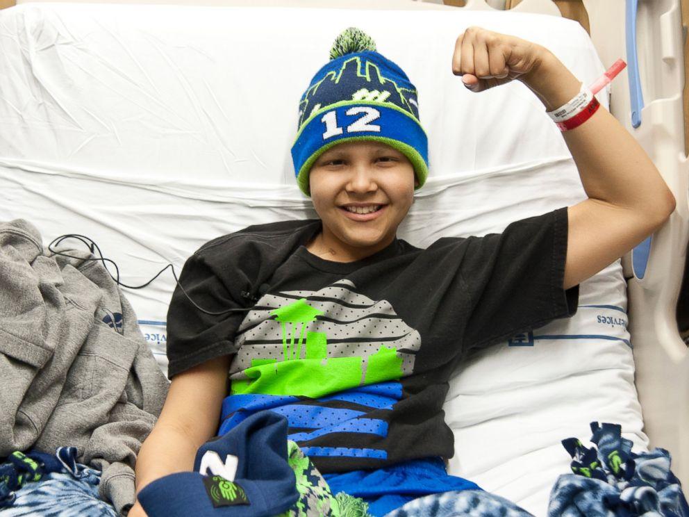 PHOTO: Seattle Childrens Hospital patient, Dane Bowman-Weston flexes for Strong Against Cancer, Jan. 27, 2015.