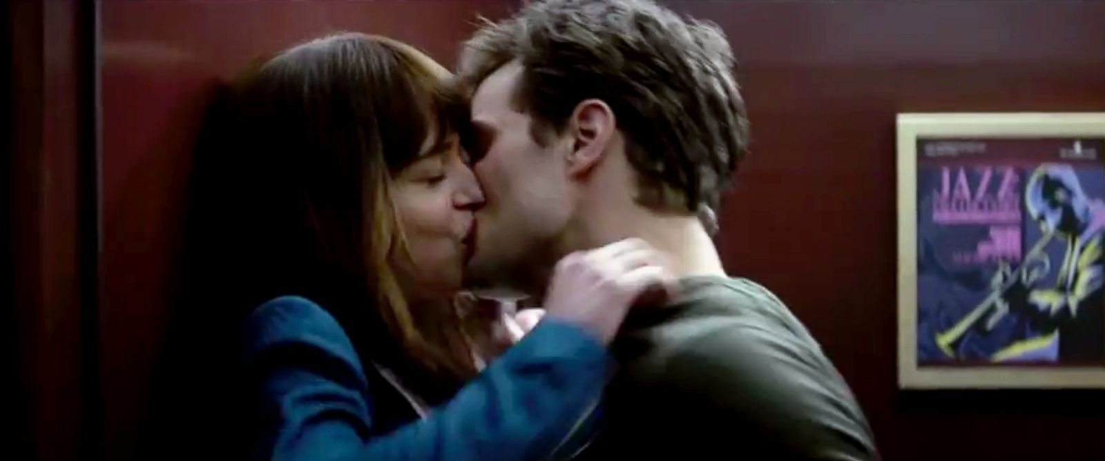 "PHOTO: Dakota Johnson as Anastasia Steele and Jamie Dornan as Christian Grey in the ""Fifty Shades of Grey"" trailer."
