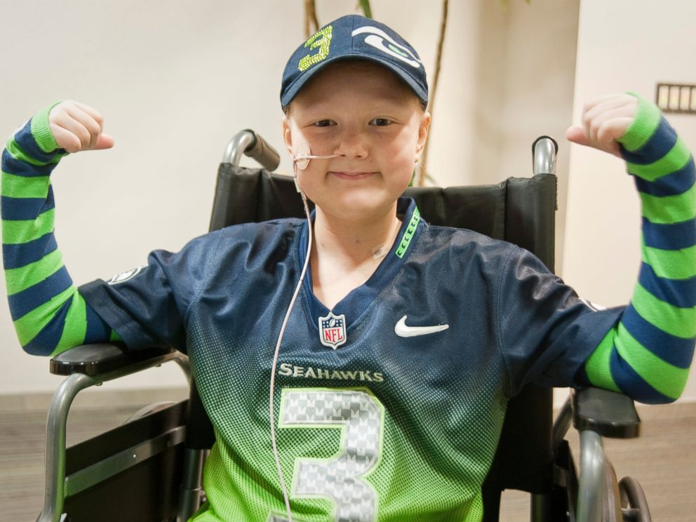 PHOTO: Seattle Childrens Hospital patient, Kennedy ODay flexes for Strong Against Cancer in her FiveLo arm socks, Jan. 27, 2015.