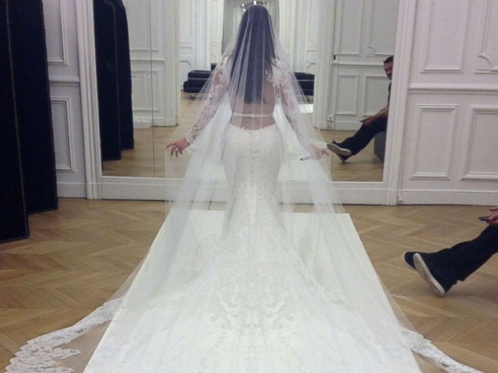 PHOTO: Kim Kardashian had one last fitting of her Givenchy Haute Couture lace gown at the Givenchy atelier in Paris before the wedding ceremony. <a href=http://www.eonline.com/news/545405/kim-kardashian-and-kanye-west-s-first-photos-as-a-married-couple-s