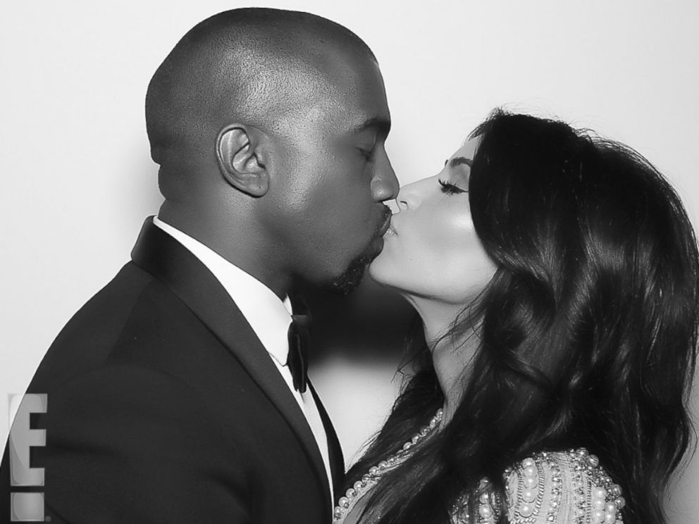 PHOTO: Kanye West and Kim Kardashian kiss shortly after their nuptials took place at Forte di Belvedere in Florence, Italy, May 24, 2014. <a href=http://www.eonline.com/news/545405/kim-kardashian-and-kanye-west-s-first-photos-as-a-married-couple-see-the-