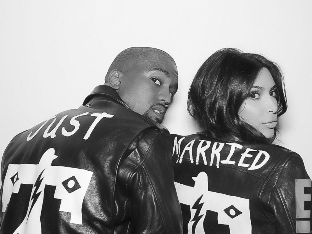 PHOTO: Kanye West and Kim Kardashian wear matching jackets shortly after their nuptials took place at Forte di Belvedere in Florence, Italy, May 24, 2014.<a href=http://www.eonline.com/news/545405/kim-kardashian-and-kanye-west-s-first-photos-as-a-married